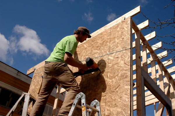 construction worker building house nailer osb sheathing