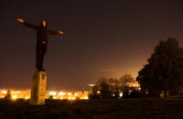 graveyard cemetary man cross night stars long exposure